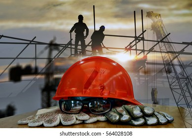 Double exposure of safety standard set  on working table and construction background .