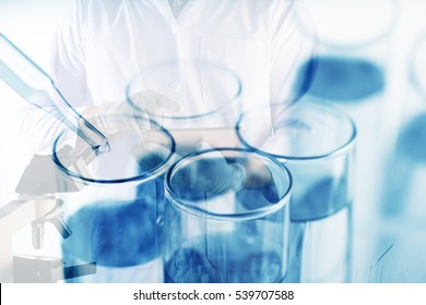 Double exposure of Scientists or doctor is using tablet with Laboratory glassware containing chemical liquid, science research concept,vintage process style