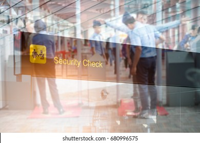 Double exposure of  security check airport sign ,Airport security check at gates with metal detector and scanner