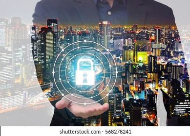Double exposure of security concept - businessman show key lock symbol on hand with city overlay