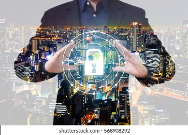 Double exposure of security concept - businessman show key lock symbol between hands with city overlay