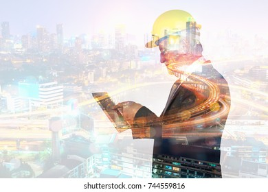Double Exposure Senior Businessman or Architect use Digital Wireless Mobile Phone with City Building and Expressway as High Speed Internet Technology for Business industrial Telecommunication Concept