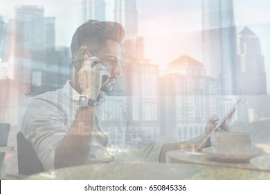 Double exposure of serious businessman making a phone call