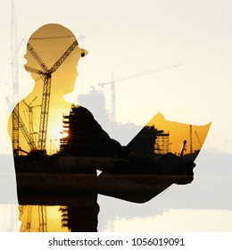 Double exposure of silhouette black foreman worker building Industrial  construction cranes