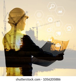 Double exposure of silhouette black foreman worker building construction cranes with icons technology