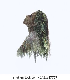 Double exposure silhouette head portrait of woman combined with green trees background. Conceptual image showing unity of human with nature. Ecology, freedom, peace. Isolated on white
