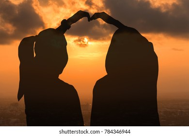Double exposure of silhouette lovers on sunset background. Valentine's Concept