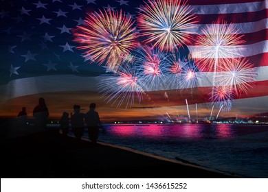 Double exposure of Silhouette people looking beautiful fireworks display on celebration night with USA flag, showing on the sea beach with reflection on water. 4th July Independence day concept.