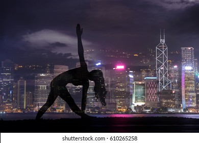 Double exposure of Silhouette yoga woman against Hong Kong city at night