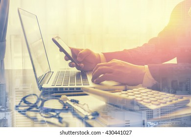 Double exposure of Social network user login,man working from home using smart phone and notebook computer, man's hands using smart phone for writing,tablet,smartphone,vintage color,selective focus