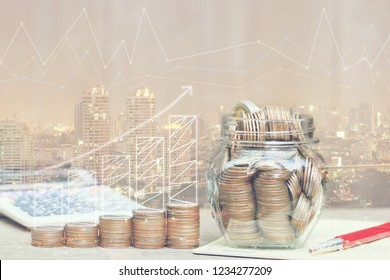 Double exposure of Stack of coins money and the glass bottle and graph on city background, investment and business concept