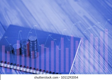 Double exposure Steps of coins stack and notebook paper on table with financial graph and copy space for text, financial and business planning concept idea.