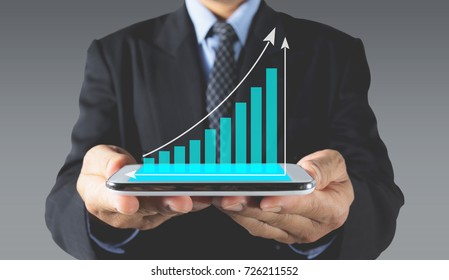 Double exposure stock financial indices with smart phone and businessman. Financial stock market in accounting market economy analysis.