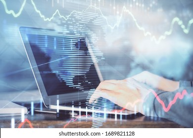 Double exposure of stock market graph with man working on laptop on background. Concept of financial analysis.