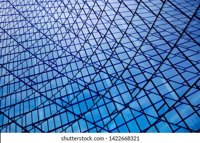 Double exposure of structural glazing. Generic modern architecture fragment with glass ceiling, roof or wall made of transparent facade panels. Abstract geometric background with complex grid pattern.