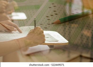 double exposure of students writing a test in their exercise and exam multi-choice in classroom,