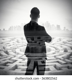 Double exposure of stylish businessman and labyrinth with city on the background. Vertical