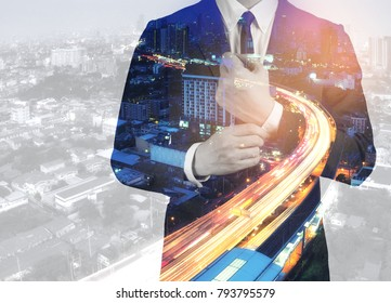 Double exposure of success business man city background.time for business.concept fast move business.