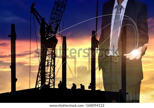 Double exposure of success businessman show his hand to success concept and Construction , Management concept .