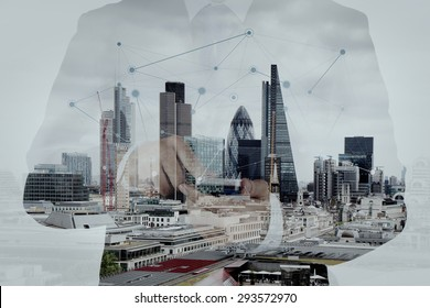 Double exposure of success businessman using smart phone and social media diagram with london city blurred background