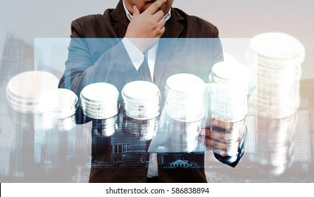 Double exposure of success businessman using digital tablet with rows of  stack coins background,  rows of coins for finance and banking concept