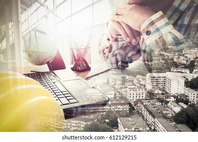 Double exposure of success land developer working in office with laptop