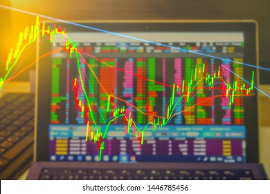 Double exposure. Technical price graph and indicator, candlestick chart and stock trading computer screen on table. Market volatility. For Crypto currency trading, stock market and economics concept.