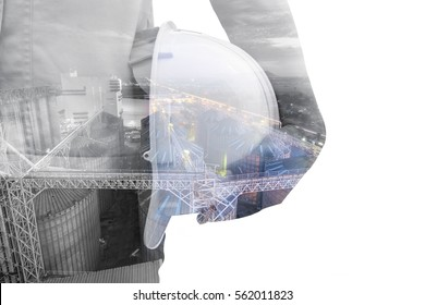 Double exposure Torso of engineer or worker hold in hand white helmet for workers security factory industry background  on white background. Set of storage tanks raw material feed mills