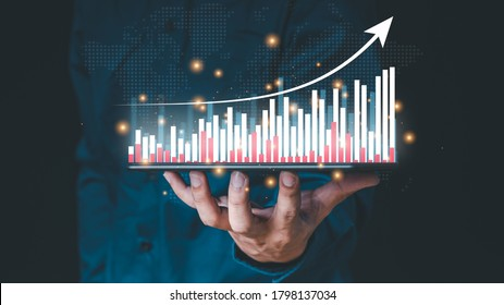 ฺBusiness in Double Exposure touches a virtual screen that shows a crypto currency with tickers or a graph. With indication, a chart shows a rising stock symbol. candlesticks for market data exchange
