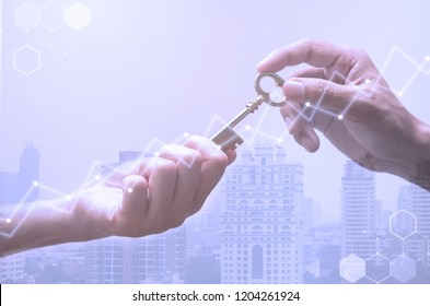 Double exposure of tower building and hand's of people holding the key. same  as the factor to success in property investment , home investment.