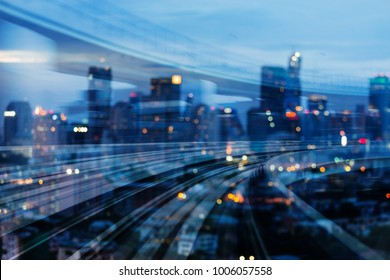 Double exposure train track curved with blurred bokeh light office downtown, abstract background