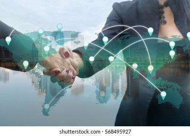 Double exposure of two business people handshake and world map with marketing online concept