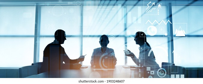 Double exposure of virtual screen and colleagues at business meeting in office