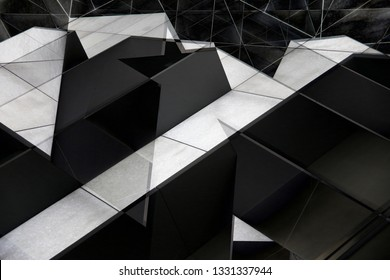 Double exposure of wall panels resembling fragment of futuristic building. Abstract modern architecture. Minimalist background with bizarre angular structure of black and white elements.