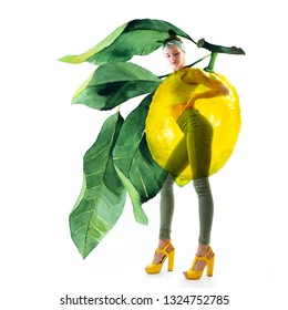 Double exposure of watercolor lemons with full-length portrait of beautiful dancing girl in green pants, lime top and yellow shoes. Teen girl hip-hop dancer with hand drawn vibrant jucy lemons