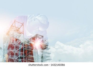 Double exposure welding Industrial worker welding metal piping using Mig welder and wear equipment protection on refinery oil or powerplant background.