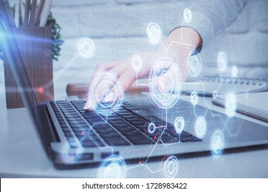 Double exposure of woman hands working on computer and data theme hologram drawing. Tech concept.