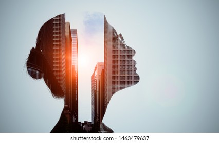 Double exposure of woman silhouette and modern city skyline.