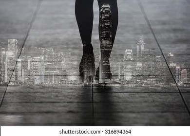 Double exposure of woman walking with Hong Kong city. Black and white image.