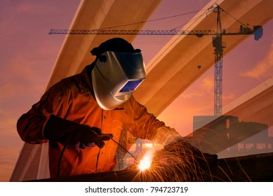 Double exposure of Worker welding steel structure with industrial crane and urban expressway. photo concept for Construction industry and engineering work.