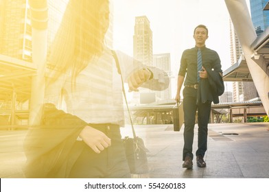 Double Exposure of Young Adult Businessman Walking with Business Woman Looking to Watch as Urban City People Lifestyle Concept.  Late Appointment Dating Feel of Working Meeting Love Couple.