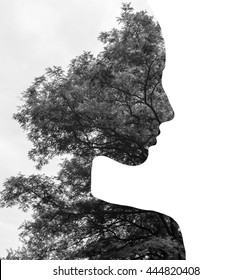 Double exposure of young beautiful girl among the leaves and trees. Black and white silhouette Isolated on white background.