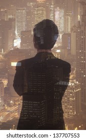 Double exposure of young businessman and the cityscape of Shanghai, China