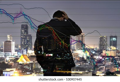 Double exposure of Young businessman his declining share. Bad business, economy in recession! and city background.