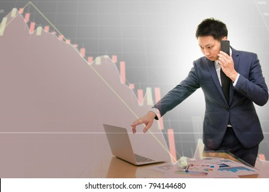 Double exposure of young businessman talking on the phone with stress and technical graph of stock losses in background.