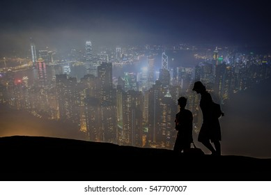 Double exposure of  young couple go to travel ,background Hong Kong viewed from the Peak.