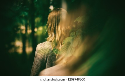 Double exposure of young woman and autumn forest.