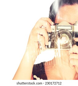 Double exposure of  young woman holding old camera and nature background