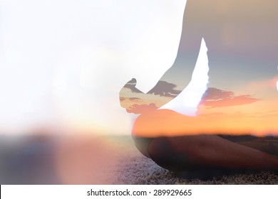Double exposure of young woman  silhouette practicing yoga