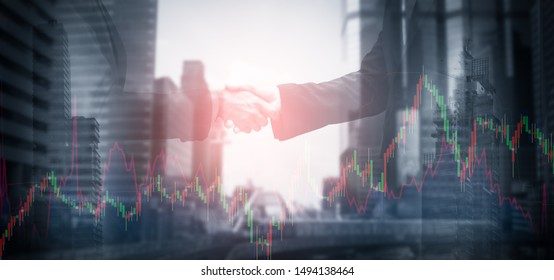 Double exposure-Successful collaboration concept of CEO in business mergers,businessmen shake hands,making deals,agree to partner,stock chart and city background,web banner header panoramic horizontal